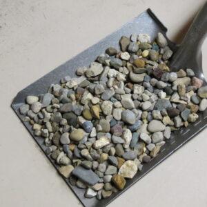 A shovel full of pebbles